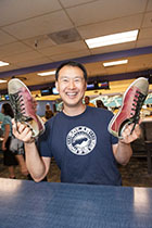 Guest Anthony Chen picked out his lucky bowling shoes.